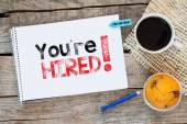 Notebook with you're hired ! sign — Stock Photo