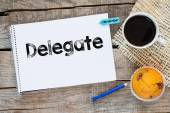 Notebook with delegate sign — Stock Photo