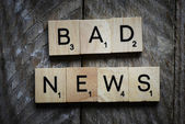 Letters spelling bad news — Stock Photo