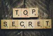 Letters spelling top secret — Stock Photo