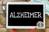 Tablet pc with word Alzheimer — Foto de Stock