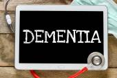 Tablet pc with word Dementia — Stock Photo