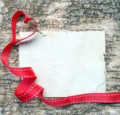 红丝带在心的形状 — 图库照片