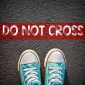 Sneakers and word do not cross — Stock Photo