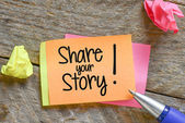 Note with Share your story — Stock Photo