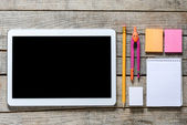 Tablet pc and school supplies — Stock Photo