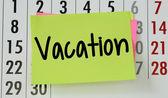 Vacation on calendar background — Stockfoto