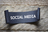 Papper with social media — Stock Photo