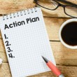 Notebook with action plan — Foto de Stock   #65879671