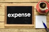 Expense on blackboard with  coffee, — Stock Photo
