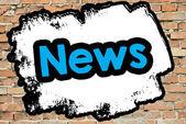 Palavra de notícias na parede de tijolo — Fotografia Stock