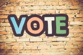 Vote On brick wall — Stock Photo