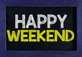 Happy weekend On blackboard — Stock Photo