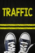 Male sneakers with traffic — Stock Photo