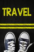 Male sneakers with travel — Stock Photo