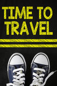 Male sneakers with time to travel — Stock Photo