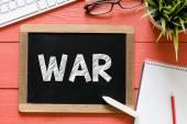 War word Handwritten  on blackboard — Stock Photo
