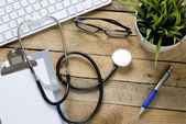 Stethoscope with clipboard  and keyboard — Stock Photo
