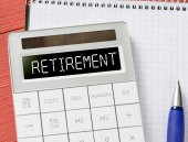 Calculator with retirement word — Stock Photo