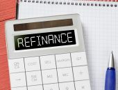 Calculator with refinance word — Stock Photo