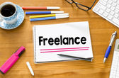 Freelance word and cup of coffee — Stock Photo