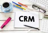 CRM Written on white paper — Stock Photo