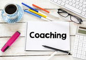 Coaching word  with cup of coffee — Stockfoto