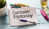 Notepad with customer relationship — Stock Photo