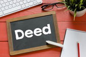 Blackboard with deed and  keyboard — Stock Photo
