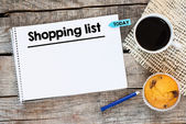 Notebook with shopping list — Stock Photo