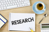 Research and cup of coffee — Stock Photo