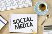 Social media and cup of coffee — Stock Photo