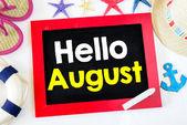 Blackboard with hello august — Stock Photo