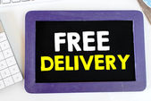 Blackboard with and free delivery — Stock Photo