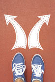 Male sneakers with drawn direction arrows — Stock Photo