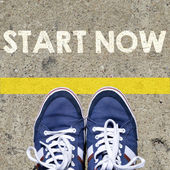 Male sneakers with start now — Stock Photo