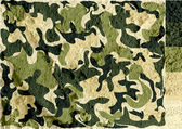 Camouflage pattern design  on wall texture background — Stockfoto