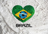 Heart Flag of Brazil with Soccer ball  on wall texture backgroun — Stock Photo