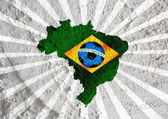 Flag and map of Brazil with Soccer ball on wall texture backgrou — Stock Photo