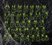 Handen ritade bokstäver teckensnitt skrivet på väggen textur bakgrund desig — Stockfoto