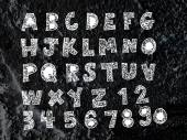 Hand drawn letters font written on wall texture background desig — Stock Photo