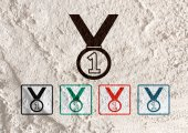 Medal icons  on Cement wall Background texture — Stock Photo