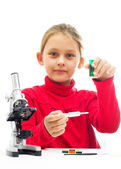 Little girl conducting research — Stock Photo