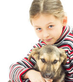 Portrait of a little girl and a dog on a white background — Stockfoto