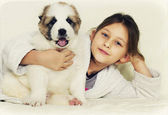 Child with a puppy — Stock Photo