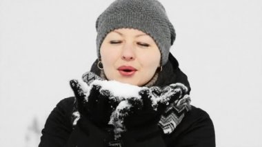 Woman Blowing Snow — Stock Video