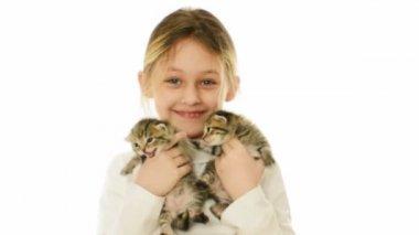 Girl laughing holding two kittens — Vídeo de Stock