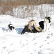 Blond Girl playing with dogs — Stock Video #61860135