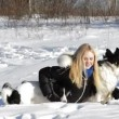 Blond Girl playing with dogs — Stock Video #61861055