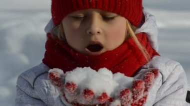 Little girl blowing snow — Stock Video